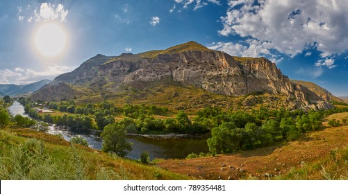 Panorama of Vardzia cave town and monastery with Kura river and valley in Georgia country