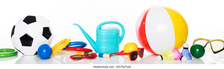 panorama with various summer toys for leisure activities, isolated in front of white background