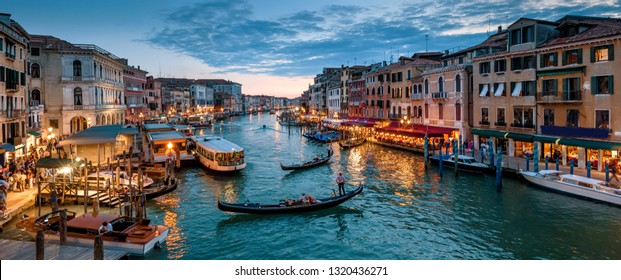 Panorama of Venice at night, Italy. Beautiful cityscape of Venice in evening. Panoramic view of Grand Canal at dusk. It is one of the main tourist attractions of Venice. Romantic water trip in Venice.