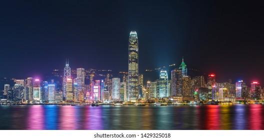 Panorama of Victoria harbor of Hong Kong city at night