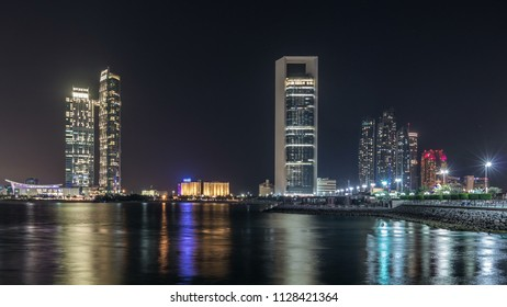 Panorama view of Abu Dhabi Skyline and seafront at night timelapse, United Arab Emirates. View of Corniche with illuminated skyscrapers