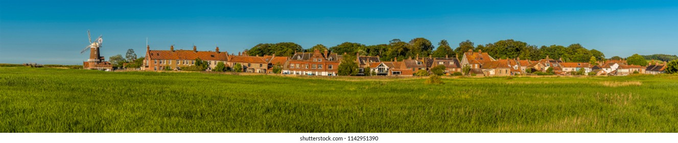 A panorama view across the marshes of the village of Cley, Norfolk, UK