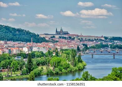 Panorama view across the river Vltava to centre of historical Prague with bridges, Prague Castle. Spring view of czech capital cityscape.