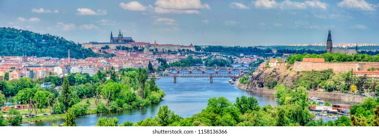 Panorama view across the river Vltava to centre of historical Prague with bridges, Prague Castle. Spring view of czech capital cityscape.