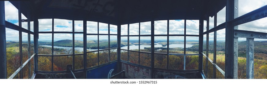 Panorama view of Adirondack Mountains inside fire tower, Adirondack fire tower challenge beautiful view of the Mountains, tower climb