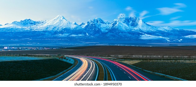 Panorama view after sunset onHigh Tatras national park mountains and highway D1 in Slovakia
