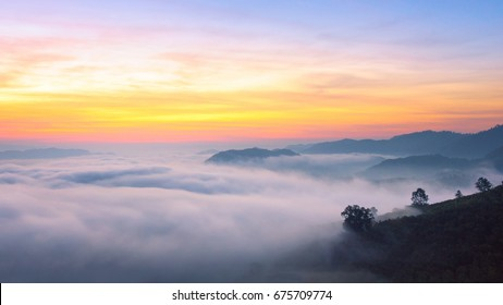 Panorama view of amazing mist moving over the nature mountains during sunrise at mountains area in Thailand.