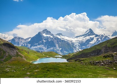 Panorama view of Bachalpsee and the snow coverd peaks including Schreckhorn, Wetterhorn with glacier of swiss alps, on Bernese Oberland, Switzerland.