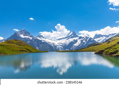 Panorama view of Bachalpsee and the snow peaks with glacier of swiss alps