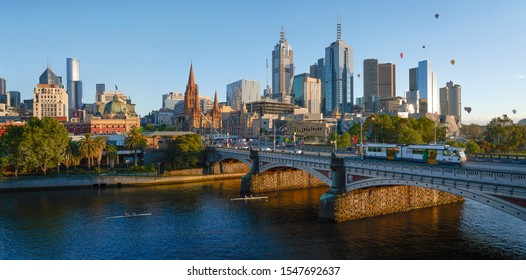 Panorama view of beautiful Melbourne cityscape skyline at sunrise in Australia .