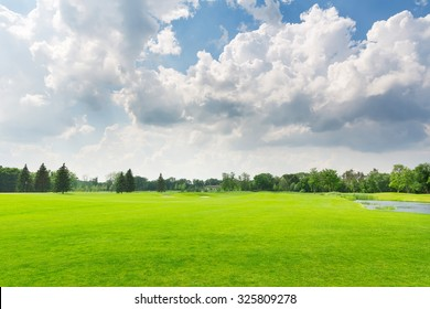 Panorama view of beautiful summer park with cloudy sky