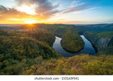 Panorama view of beautiful sunset over river Moldau at autumn. Maj viewpoint near Teletin, Prague, Europe.
