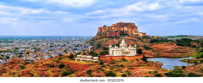 Panorama view of the blue city of Jodhpur, Rajasthan, India, with Mehrangharh Fort and Jaswant Thada mausoleum