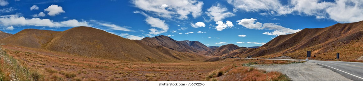 Panorama view of brown and complicated mountain of Lindis Pass, south island, New Zealand in the blue sky