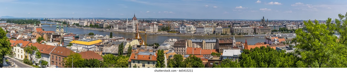 A panorama view of Buda and Pest districts in Budapest from the Fisherman's Bastion in summertime