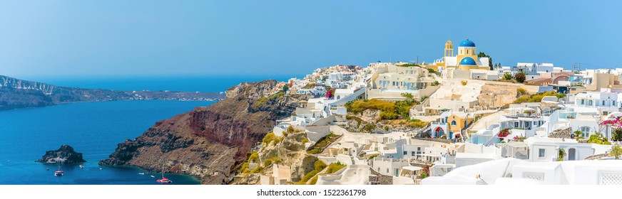 A panorama view of the Castle and town of Oia on the edge of the Caldera in Santorini in summertime