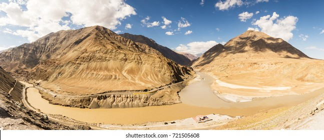 Panorama view confluence of Sindhu (Indus) and Zanskar Rivers these two lines are different shades of color in summer Himalayas, Ladakh, India.