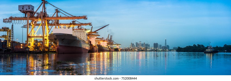 Panorama view Container Cargo freight ship with working crane bridge in shipyard at twilight for Logistic Import Export background