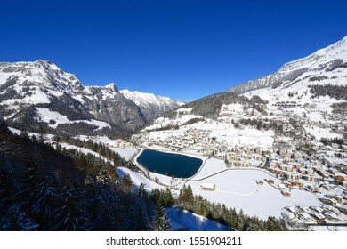 Panorama view of Engelberg village with the lake, view from the cable car up to the Titlis mountain in winter, Engelberg Switzerland.