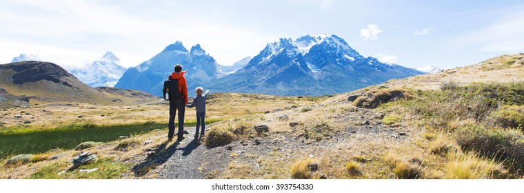 panorama view of family enjoying active vacation in patagonia and hiking in torres del paine national park, chile