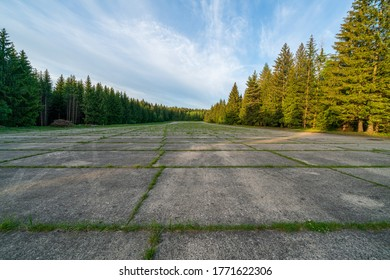 """Panorama view of former airport under """"Hejlak"""". Abandoned military airport in the middle of the forest.  Popular tourist destination in Brdy, The Czech Republic."""