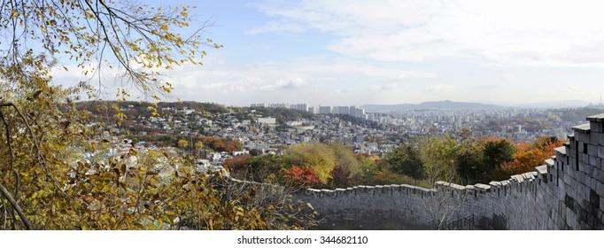 Panorama view of the fortress wall of Bugaksan mountain near Seoul, South korea.The wall stretches 18.6 km along the ridge of Seoul's four inner mountains, Baegaksan, Naksan, Namsan, and Inwangsan