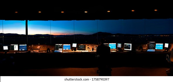 Panorama view from inside an air traffic control tower taken at night, Canada