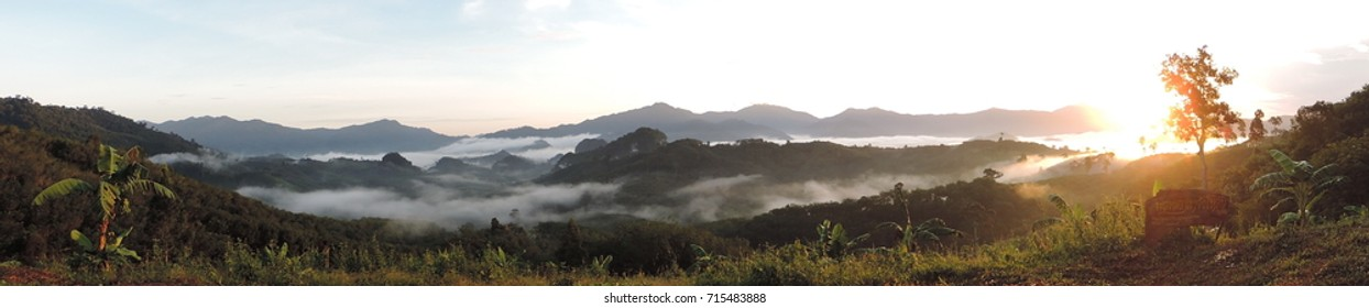 """Panorama view of 'Khao Chang Lon Krung Ching' in NakhonSri Thammarat, Thailand. (Thai language depicted in the photo. Signify """"Khao Chang Lon Krung Ching Sea of Mist"""")"""