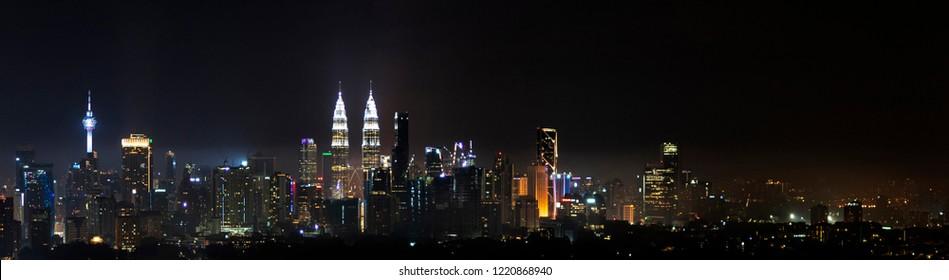 Panorama view of Kuala Lumpur city skyline at night