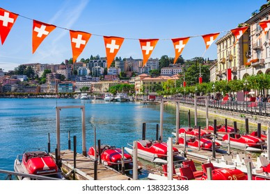 Panorama view of the lake Lugano, mountains and city Lugano, Ticino canton, Switzerland. Scenic beautiful Swiss town with luxury villas. Famous tourist destination in South Europe