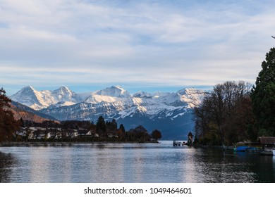 Panorama view of the lake Thun and Bernese Apls including Jungfrau, Monch and Eiger Northface from the lakeside of Thun, Canton of Bern, Switzerland.