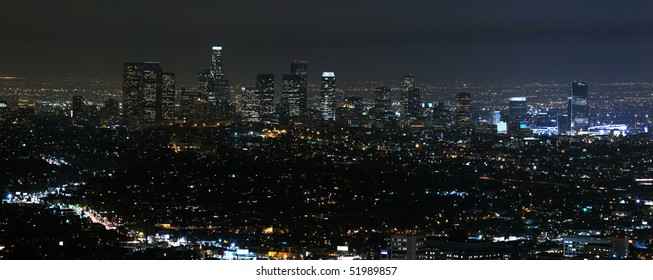 Panorama view of Los Angeles cityscape at night.