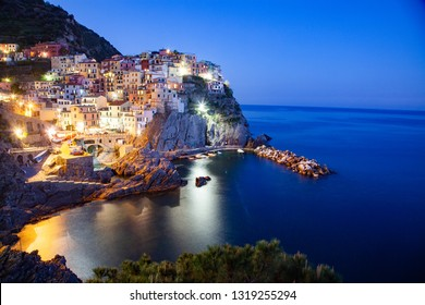 panorama view of Manarola village one of Cinque Terre at night in La Spezia, Italy