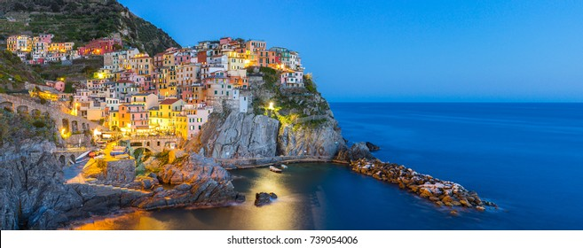Panorama view of Manarola village one of Cinque Terre at night in La Spezia, Italy.