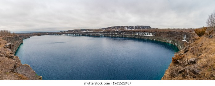 Panorama View of Marmora mine in winter, Marmora Ontario Canada , Blue shale, icicles and snow hanging from rocks, gorgeous blue lagoon