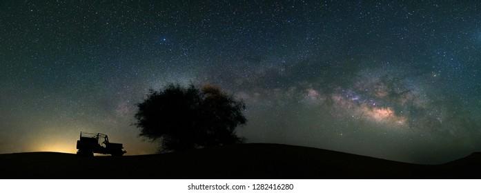 Panorama view of Milky way galaxy at Tar desert, Jaisalmer, India. Astro photography.