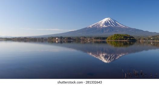 Panorama view of Mountain Fuji with reflection at Lake Kawaguchiko in spring season