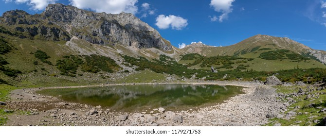 panorama view mountain lake Krumpensee on Eisenerzer Reichenstein, a mountain in the Ennstal Alps in the Austrian federal state of Styria