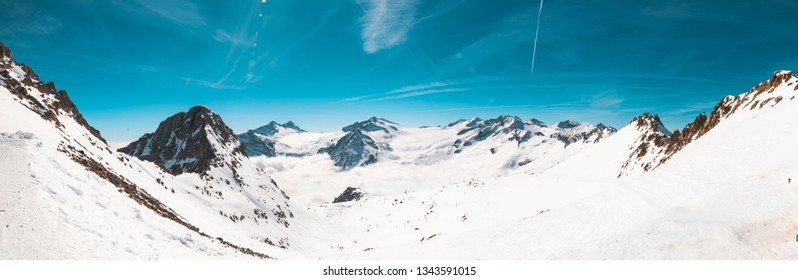 Panorama view mountain with snow in a sunny day of skiing of clouds Alpes