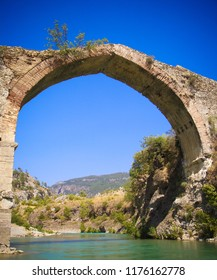 Panorama view to old ruined bridge over Dalaman river in Turkey