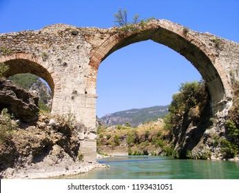 Panorama view to old ruined bridge over Dalaman river in Turkey