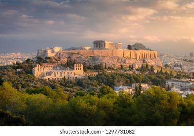 Panorama view on the Acropolis in Athens at sunrise. Scenic travel background with dramatic clouds. Greece