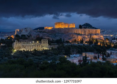 Panorama view on the Acropolis in Athens at after the sunset. Scenic travel background with dramatic clouds. Greece