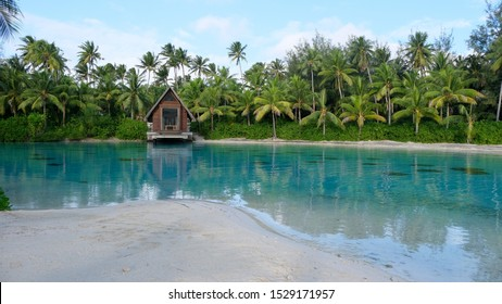 Panorama view on luxury overwater bungalows in a vacation resort in the blue lagoon with in the background the tropical island of Bora Bora, near Tahiti, in the pacific archipelago French Polynesia.