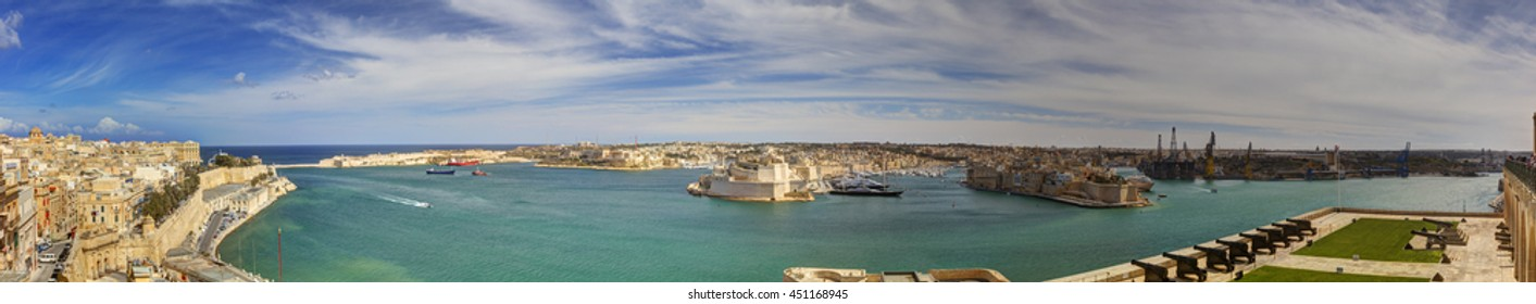 Panorama view on Valletta Grand harbor from the historic Upper Barraka garden area in Malta with historic line of cannons - Saluting Battery of the St. Peter & Paul Bastion of the Valletta Land Front