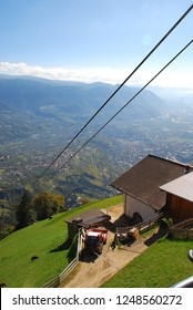 Panorama view on valleys (Meran) and mountains in the italian alps standing at the cableway station Hochmuth (Meran, South Tyrol, Italy)