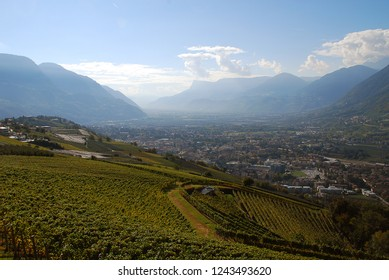 Panorama view on valleys and mountains in the italian alps, nearby Meran, South Tyrol, Italy. In the middle Meran