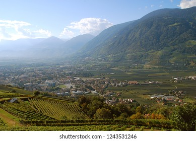 Panorama view on valleys and mountains in the italian alps, nearby Meran, South Tyrol, Italy. On the left Meran