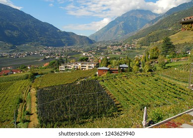 Panorama view on valleys and mountains in the italian alps, nearby Meran, South Tyrol, Italy. On the left Meran, on the right Vellau
