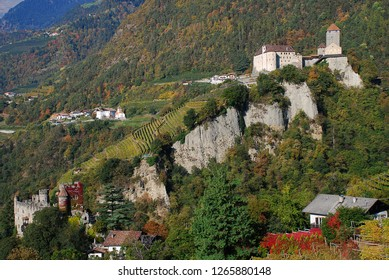 Panorama view on valleys and mountains in the italian alps, nearby Meran, South Tyrol, Italy. On the right the Castle Tyrol, on the left the Brunnenburg castle